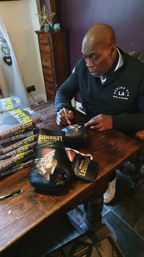 Frank Bruno signing the limited edition black legend gloved in silver