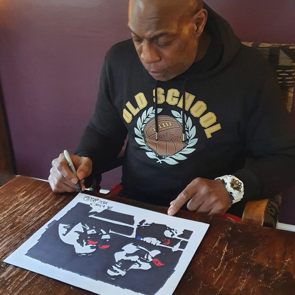 Frank signing the coloured gloves print